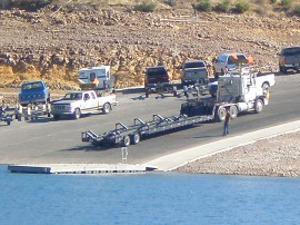 Houseboat Trailer about to pull a Corinthian out of the water